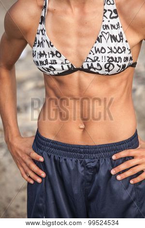muscular female abdominal tension