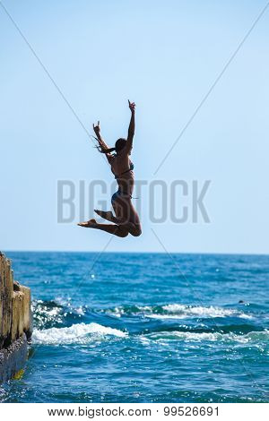 The girl jumping in the sea