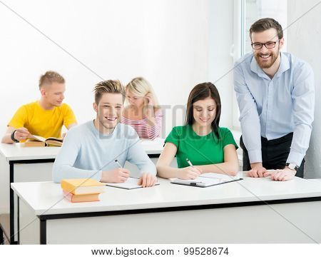 Students and the teacher learning in a classroom.