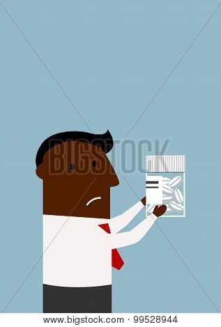 Black businessman choosing a pills