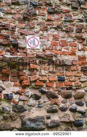 No Climbing Warning Sign On Ancient Wall
