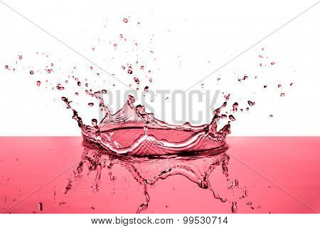 splashing red wine on white background
