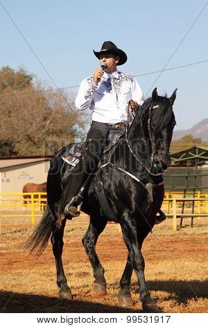 Armand The Singing Cowboy On His Black Stallion
