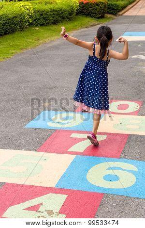 Girl Playing Hopscotch / Girl Playing Hopscotch On Playground