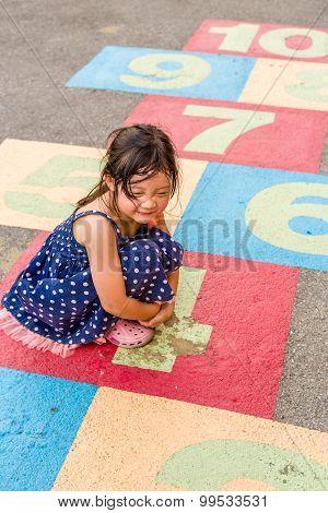 Kid Playing Hopscotch / Kid Playing Hopscotch On Playground