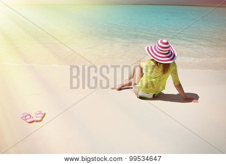 Girl relaxing on the beach of Great Exuma, Bahamas