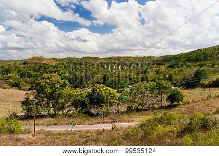 Impressive Landscape Mountain, Cuba. Panorama View On Sunny Day With Forest And Bridge.