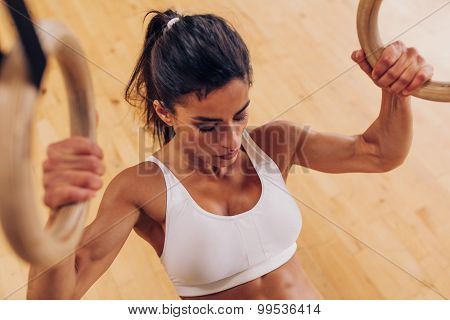 Strong Woman Doing Pull-ups Using Gymnastic Rings At Gym