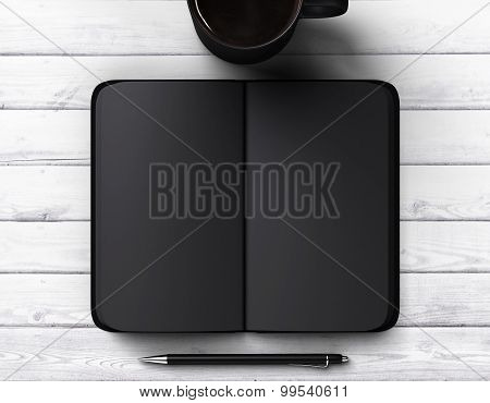 Black Blank Diary With Cup Of Coffee And Pen
