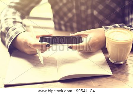 Girl With Cell Phone, Diary And Cup Of Coffee