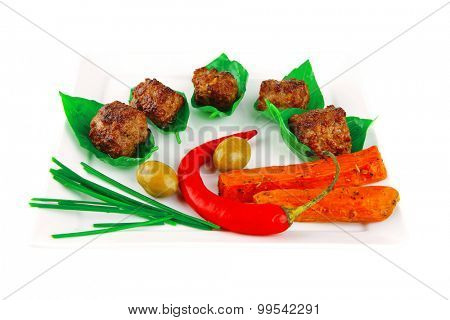 grilled french cutlets served on basil leafs