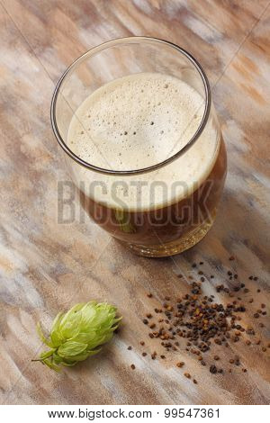 Home Made Dark Beer With Its Preparation Ingredients