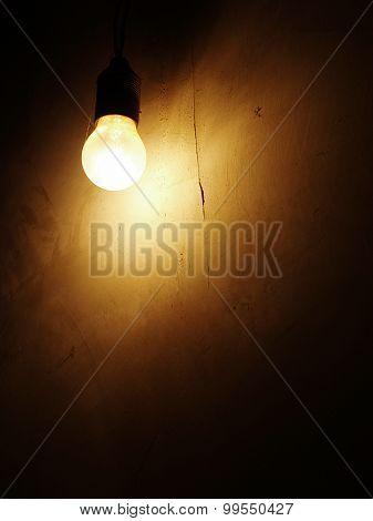 light bulb on a dark wall