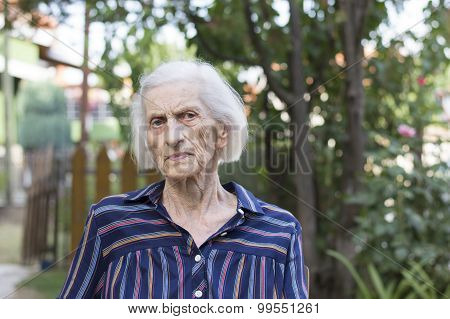 Portrait Of A Ninety Years Old Woman Outdoors
