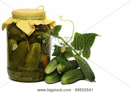 Fresh cucumbers, Pickled cucumbers in glass jar isolated on white background.
