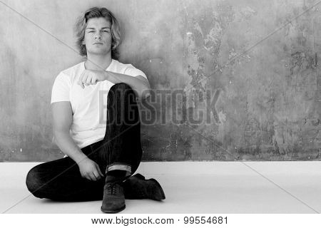 Elegant young handsome man. Studio fashion portrait. Black and white picture.