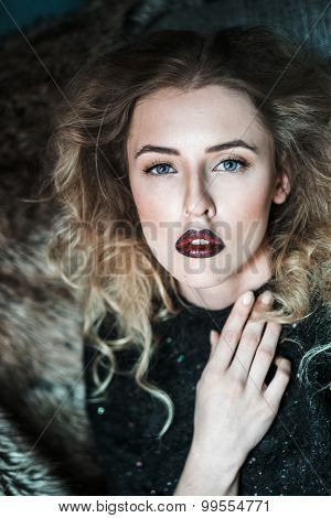 Sexy blond woman in  black dress