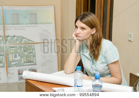Sad Student Sitting At Desk With Drawings