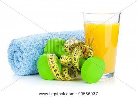 Two green dumbells, tape measure and orange juice. Fitness and health. Isolated on white background