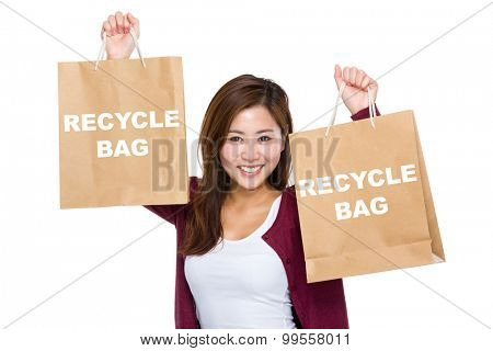 Asian woman raise up the shopping bag for showing recycle bag