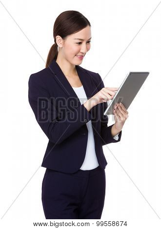 Asian young businesswoman use of the digital tablet