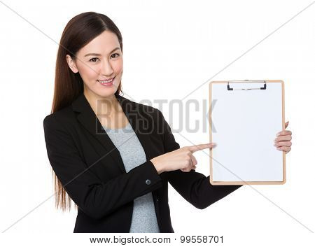 Asian businesswoman with finger point to blank page of clipboard