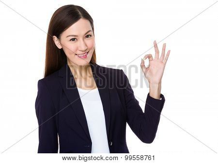 Asian young businesswoman with ok sign geature