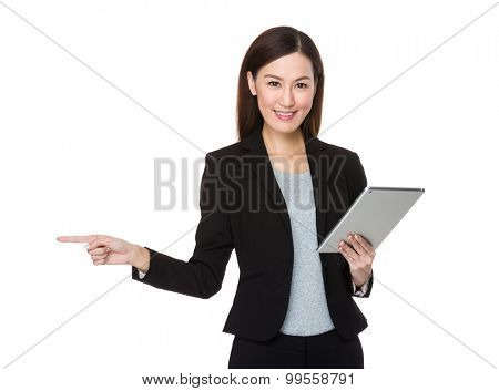 Asian businesswoman hold with tablet pc and finger point aisde
