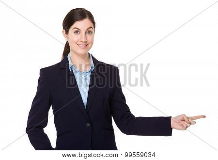 Brunette businesswoman with finger pointing aside