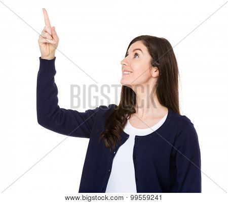 Brunette woman looking at the finger point up