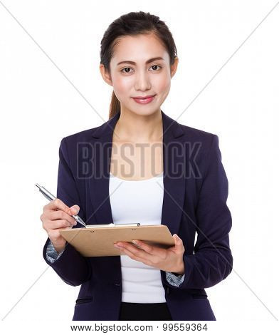 Asian businesswoman take note on clipboard