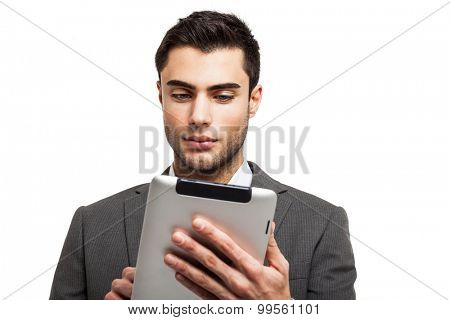 Portrait of a young business man holding his tablet