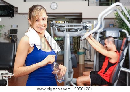 Portrait of a smiling woman in a fitness club