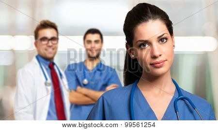 Portrait of a beautiful nurse in front of her medical team