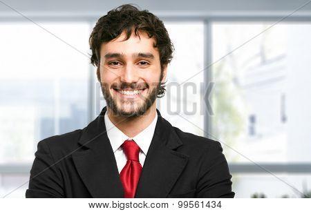 Handsome smiling manager closeup