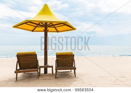 Beach Chairs With Umbrella And Sand Beach