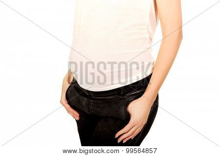 Pregnant caucasian woman with hands in pockets