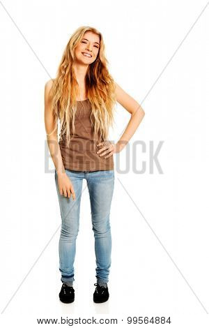 Confident teenager standing with hand on hip