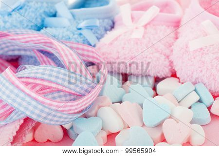 Newborn with candy hearts in pink and blue