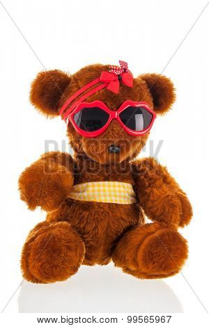Funny stuffed bear with sunglasses isolated over white background