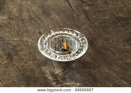 dirty ashtray on wooden table