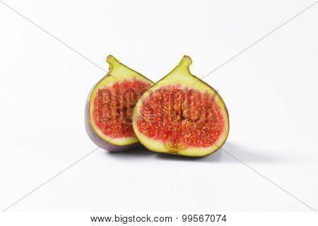 Fresh fig fruit cut into halves