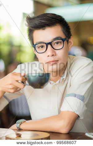 Close Up Portrait Of Business Asian Man Drinking Coffee In Vintage Cafe