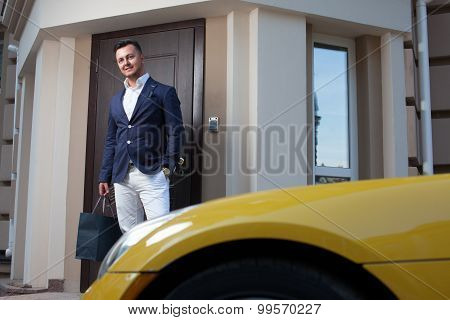 Rich Man Leaving House