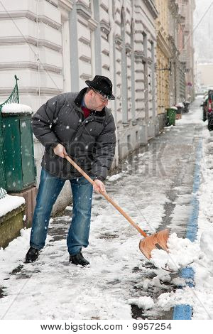 Handyman Admits Sidewalk Of Snow