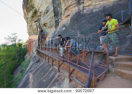 People look down from the passage to Sigiriya rock fortress in Sigiriya, Sri Lanka.