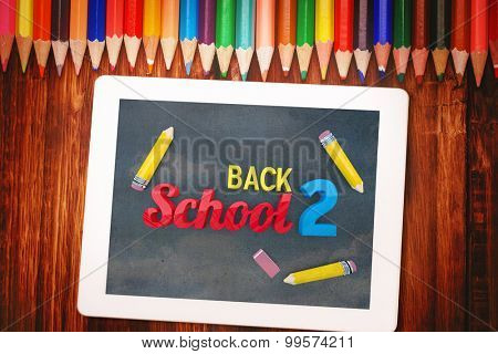 Back to school graphic against students desk with tablet pc