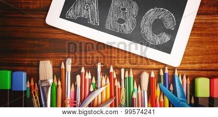 ABC against students desk with tablet pc