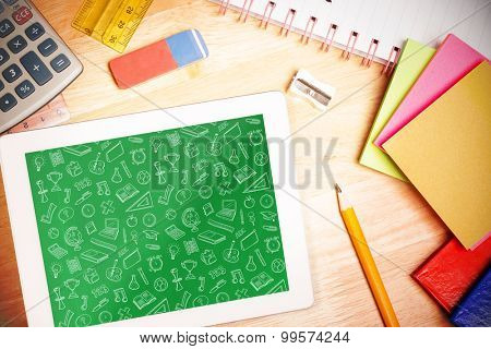 school wallpaper against students desk with tablet pc