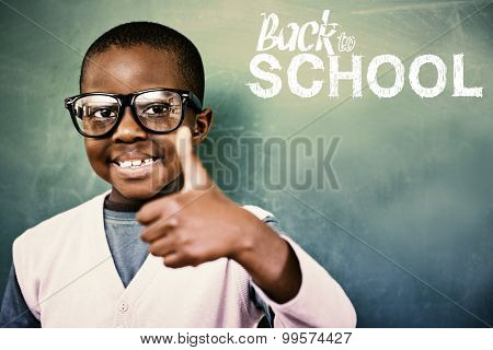 Cute pupil showing thumbs up against back to school